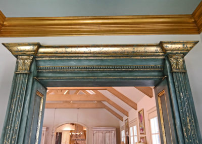 Distressed cased opening finish with gold leaf detailing, gilding of crown molding and chandelier, New Orleans