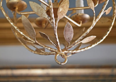 Gold leafed chandelier in New Orleans by Sylvia T Designs