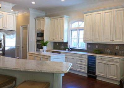 Sylvia T Designs - Kitchen Cabinet finish in an Old Metairie residence.