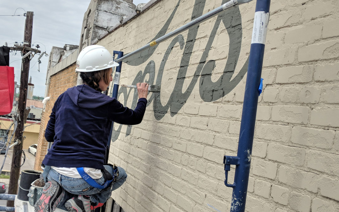 Restoring and Hand-Painting Historic Signage Four Stories Up!