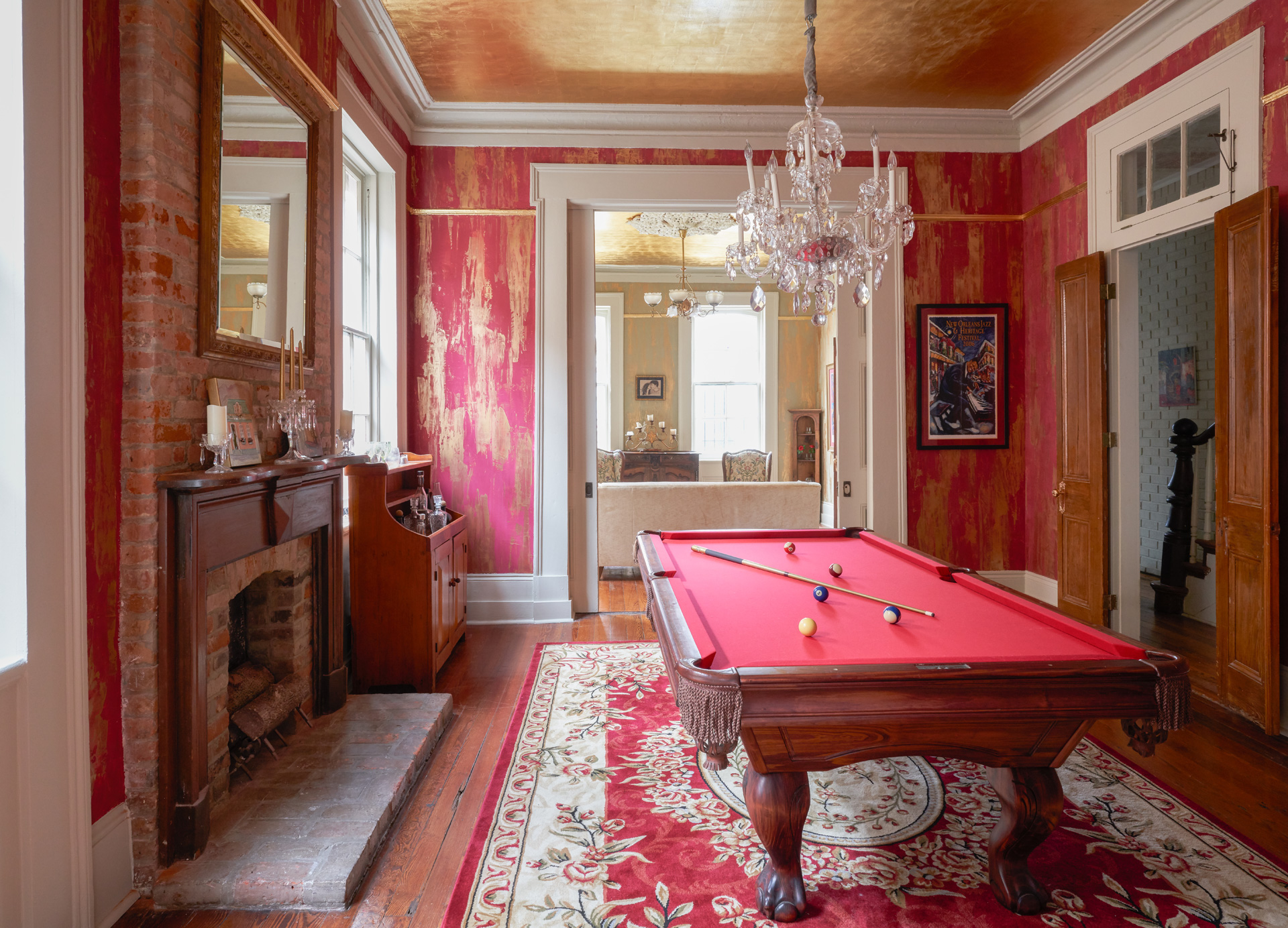 "Sylvia T Designs – French Quarter Creole Cottage – Dramatic Plaster Finishes and Gold Leaf Ceilings – Shot of the billiard room with a view of the parlor. Featuring a ""dragged"" plaster finish that combining the plaster and embedded gold tints. You can also part of the gold leaf ceiling."