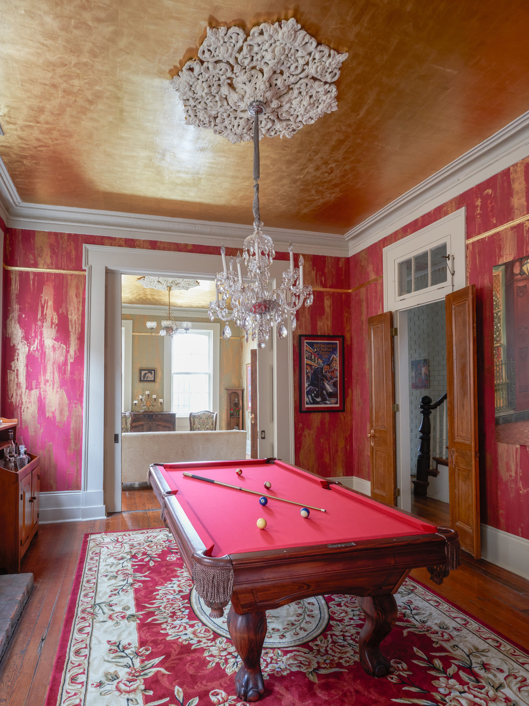 Sylvia T Designs – French Quarter Creole Cottage – Dramatic Plaster Finishes and Gold Leaf Ceilings – Wide shot of the billiard room with another view of the parlor. You can see how the elements and spaces complement each other.