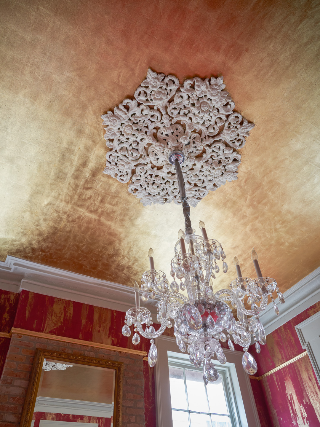 Sylvia T Designs – French Quarter Creole Cottage – Dramatic Plaster Finishes and Gold Leaf Ceilings – Shot from the billiard room highlighting the beautiful gold leaf ceiling that gorgeously reflects the plaster finished walls and ambient light.