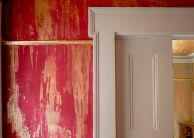 "Sylvia T Designs – French Quarter Creole Cottage – Dramatic Plaster Finishes and Gold Leaf Ceilings – ""Dragged"" plaster finish with embedded gold pigments in the billiard room."
