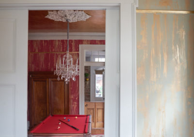 Sylvia T Designs – French Quarter Creole Cottage – Dramatic Plaster Finishes and Gold Leaf Ceilings – Shot from the parlor into the billiard room.
