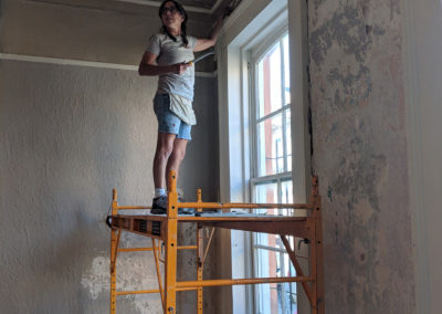 Sylvia T Designs – French Quarter Creole Cottage – Dramatic Plaster Finishes and Gold Leaf Ceilings – Working on prepping the walls. Sylvia Thompson-Dias of Sylvia T Designs.