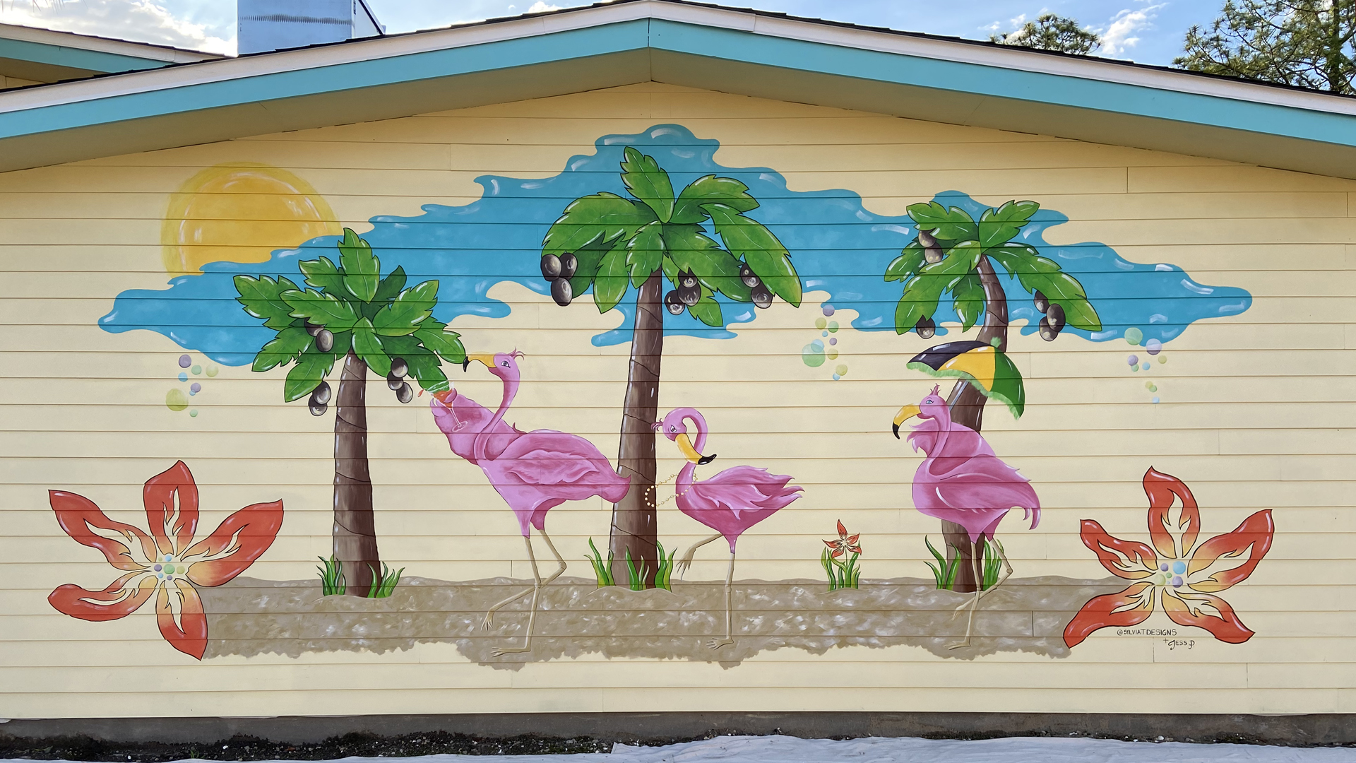Sylvia T Designs – One of two fun, branded external murals that great guests with the right vibe in the parking lot of Liz's Where Y'at diner in Mandeville, across the lake from New Orleans.